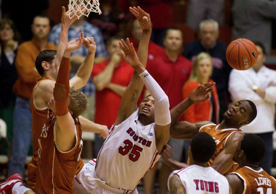 UH forward TaShawn Thomas (35) is swarmed by Texas players while taking a shot. Photo: J. Patric Schneider, For The Chronicle / © 2013 Houston Chronicle
