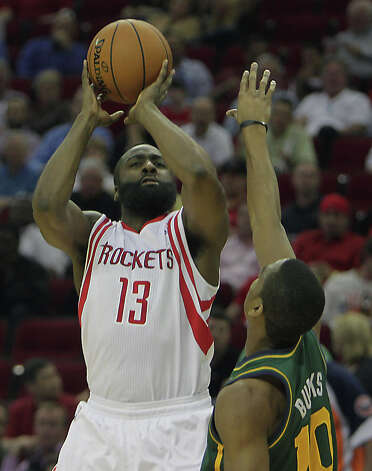 James Harden shoots the ball over Alec Burks. Photo: James Nielsen, Houston Chronicle / © 2013 Houston Chronicle