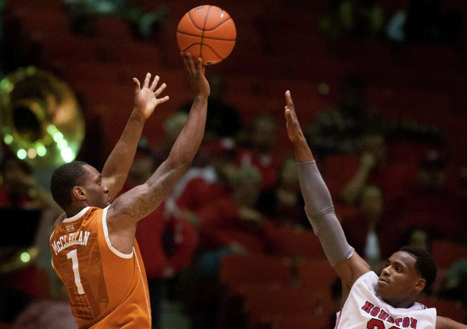 Texas guard Sheldon McClellan (1) takes a shot over UH forward Danuel House (23). Photo: J. Patric Schneider, For The Chronicle / © 2013 Houston Chronicle