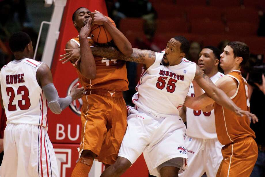 UH forward J.J. Richardson (55) and Texas center Prince Ibeh (44) battle for a rebound. Photo: J. Patric Schneider, For The Chronicle / © 2013 Houston Chronicle