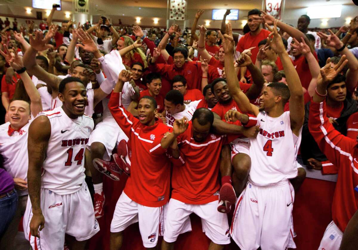 The University of Houston Cougars celebrate with fans after defeating the University of Texas 73-72 during the CBI men's postseason basketball tournament at Hofheinz Pavillion on Wednesday, March 20, 2013, in Houston.