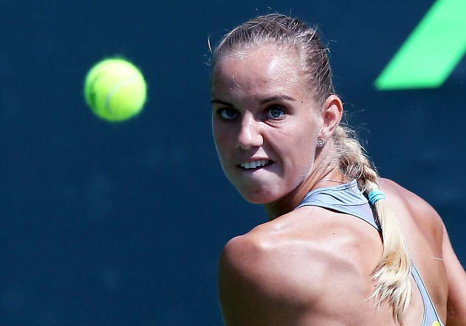 Arantxa Rus, from the Netherlands, returns the ball to Romina Oprandi, from Switzerland, during the Sony Open tennis tournament in Key Biscayne, Fla., Wednesday, March 20, 2013. (AP Photo/El Nuevo Herald, David Santiago) Photo: David Santiago, Associated Press