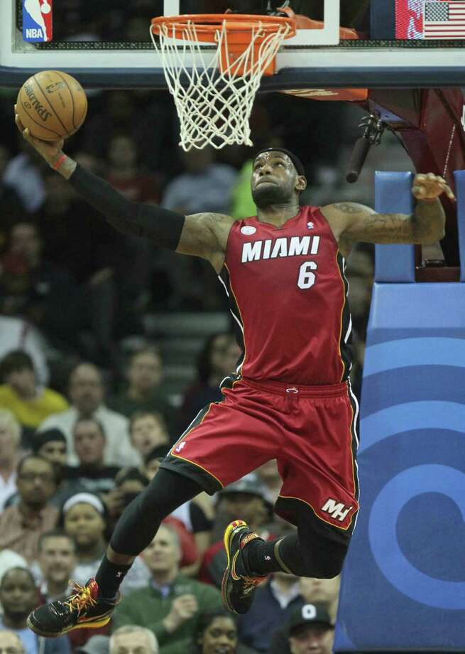 LeBron James and the Heat had to extend themselves Wednesday night to keep their streak intact. Photo: ED SUBA JR., MBR / Akron Beacon Journal