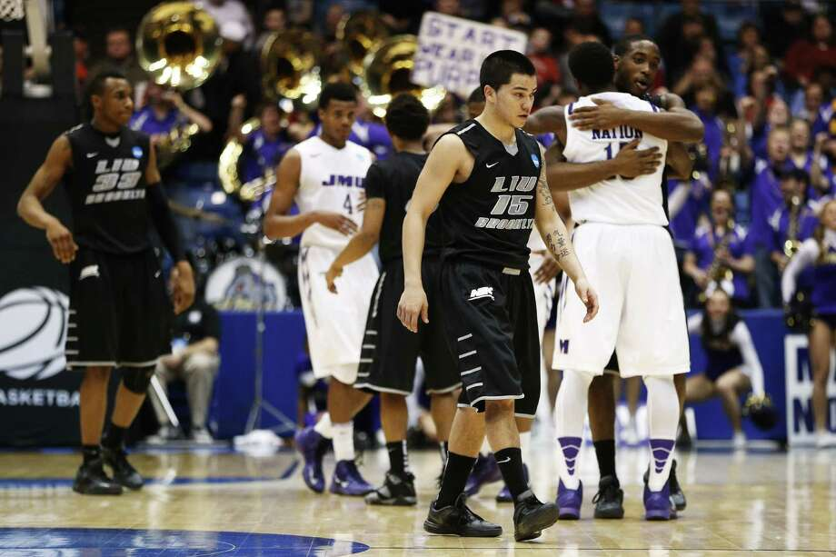 Jason Brickman (15), a Clark High product, leaves the court after his LIU Brooklyn team was beaten by James Madison. Photo: Gregory Shamus / Getty Images