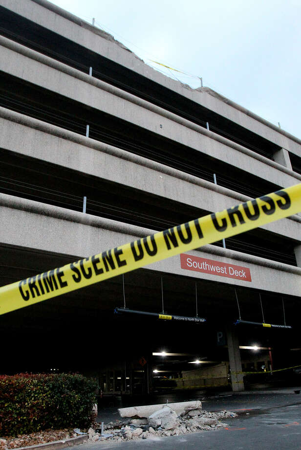Johnroy Barrones, 19, was taken to University Hospital after his car fell 49 feet from the fifth level of this garage at North Star Mall. Photo: John Davenport / San Antonio Express-News