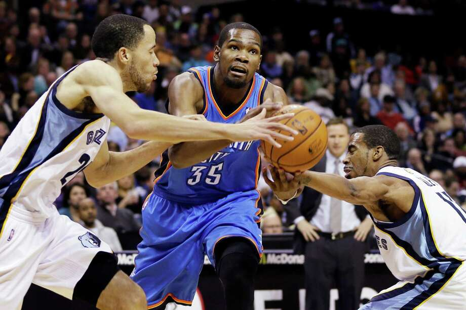 Oklahoma City Thunder's Kevin Durant (35) is pressured by Memphis Grizzlies' Mike Conley, right, and Tayshaun Prince, left, during the first half of an NBA basketball game in Memphis, Tenn., Wednesday, March 20, 2013. (AP Photo/Danny Johnston) Photo: Danny Johnston, STF / AP
