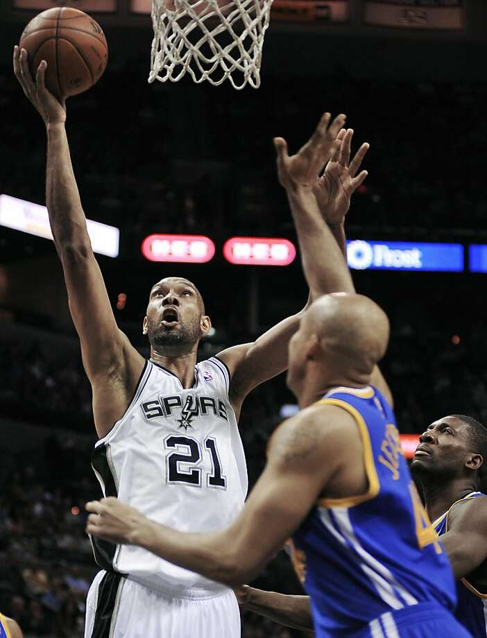 Tim Duncan had a typical night at the office - 25 points, 13 rebounds, six assists, four blocked shots. Photo: Darren Abate, Associated Press