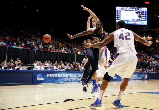 Ramon Galloway #55 of the La Salle Explorers passes the ball against Kenny Buckner #42 of the Boise State Broncos. Photo: Gregory Shamus, Getty Images / 2013 Getty Images