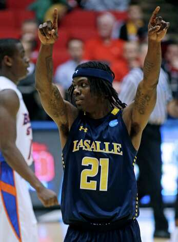 La Salle guard Tyrone Garland (21) celebrates after defeating Boise State in a first-round game. Photo: Al Behrman, Associated Press / AP