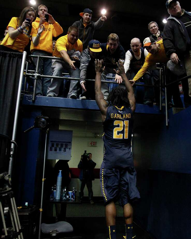 La Salle's Tyrone Garland celebrates with fans after La Salle's win against Boise State. Photo: David Maialetti, McClatchy-Tribune News Service / Philadelphia Daily News
