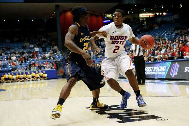 Derrick Marks #2 of Boise State drives against Tyrone Garland #21 of La Salle. Photo: Gregory Shamus, Getty Images / 2013 Getty Images