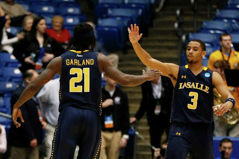 Tyrone Garland #21 and Tyreek Duren #3 of the La Salle Explorers celebrate. Photo: Gregory Shamus, Getty Images / 2013 Getty Images
