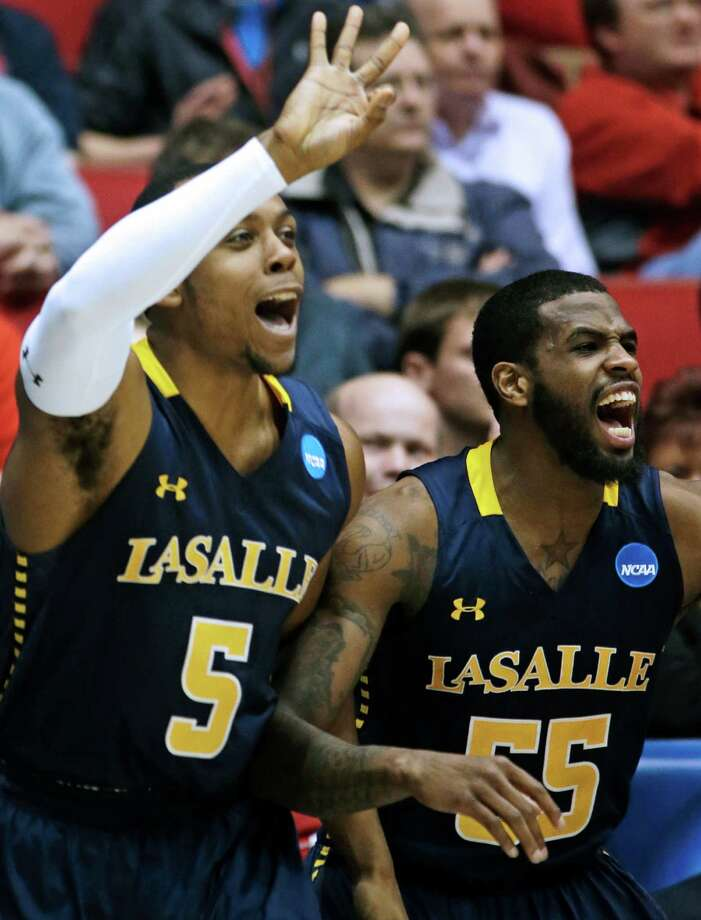 La Salle's Ramon Galloway (55) and Taylor Dunn (5) cheer from the bench after a teammate scored against Boise State. Photo: Al Behrman, Associated Press / AP
