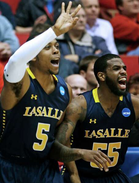 La Salle's Ramon Galloway (55) and Taylor Dunn (5) cheer from the bench after a teammate scored agai