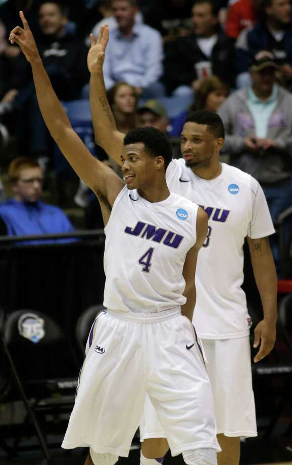 James Madison guard Charles Cooke (4) and forward Rayshawn Goins celebrate after they defeated LIU Brooklyn. Photo: Al Behrman, Associated Press / AP