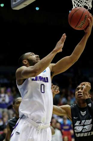 James Madison guard A.J. Davis scores against LIU Brooklyn forward E.J. Reed (33). Photo: Al Behrman, Associated Press / AP