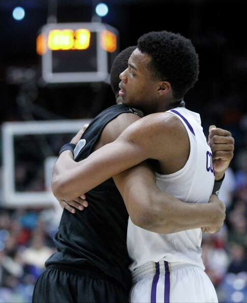 E.J. Reed, left, of LIU Brooklyn and Charles Cooke of James Madison embrace after James Madison adva