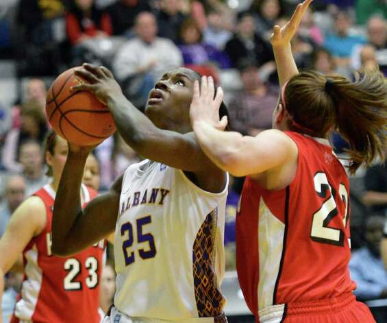 UAlbany's #25Shereesha Richards, left, gets a shot past Hartford's #22 Katie Roth during their  America East championship game at Albany Saturday March 16, 2013.  (John Carl D'Annibale / Times Union) Photo: John Carl D'Annibale / 00021515A
