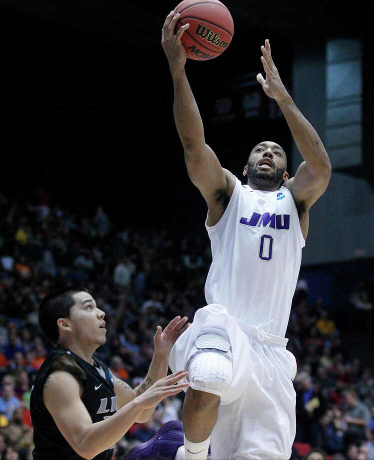 A.J. Davis (0) of James Madison is guarded by Jason Brickman of LIU Brooklyn. Photo: Barbara J. Perenic, McClatchy-Tribune News Service / Dayton Daily News