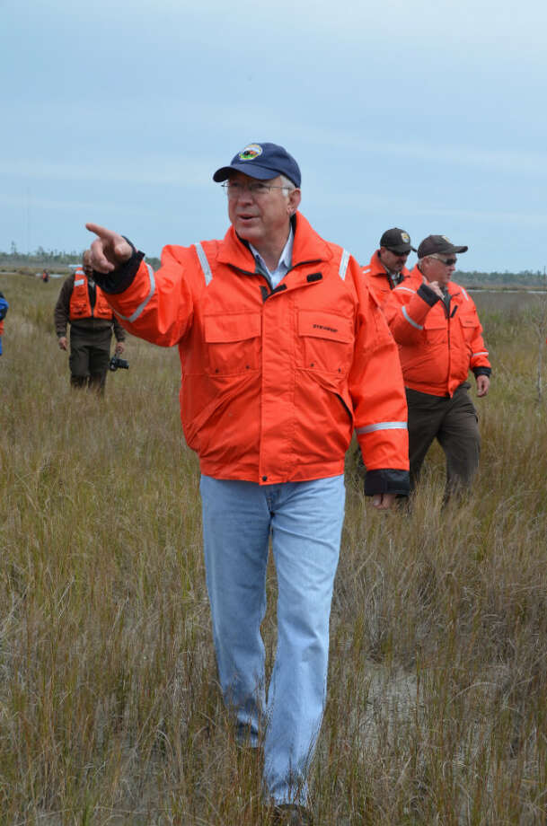 Interior Secretary Ken Salazar walks among oyster grass and other marsh plants that have flourished since being planted three years ago in the Big Branch National Wildlife Refuge.