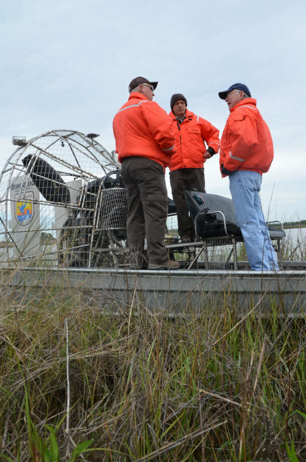 Interior Secretary Ken Salazar (right) talks to James Harris (left), senior biologist for the Southeast Louisiana Refuges Complex, and Danny Breaux (center), manager of the Big Branch National Wildlife Refuge.