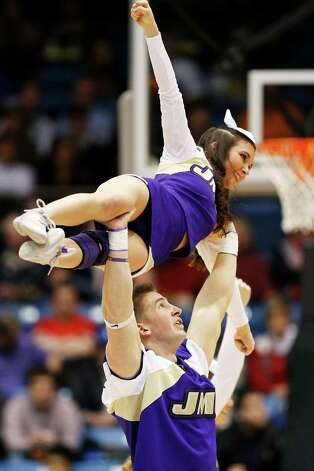 James Madison Dukes cheerleaders perform in the first half against the LIU Brooklyn Blackbirds during the first round of the 2013 NCAA Men's Basketball Tournament. Photo: Gregory Shamus, Getty Images / 2013 Getty Images