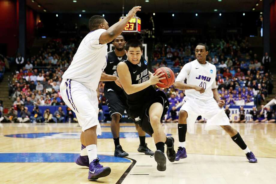 Jason Brickman #15 of the LIU Brooklyn Blackbirds drives against Rayshawn Goins #33 of the James Madison Dukes. Photo: Gregory Shamus, Getty Images / 2013 Getty Images