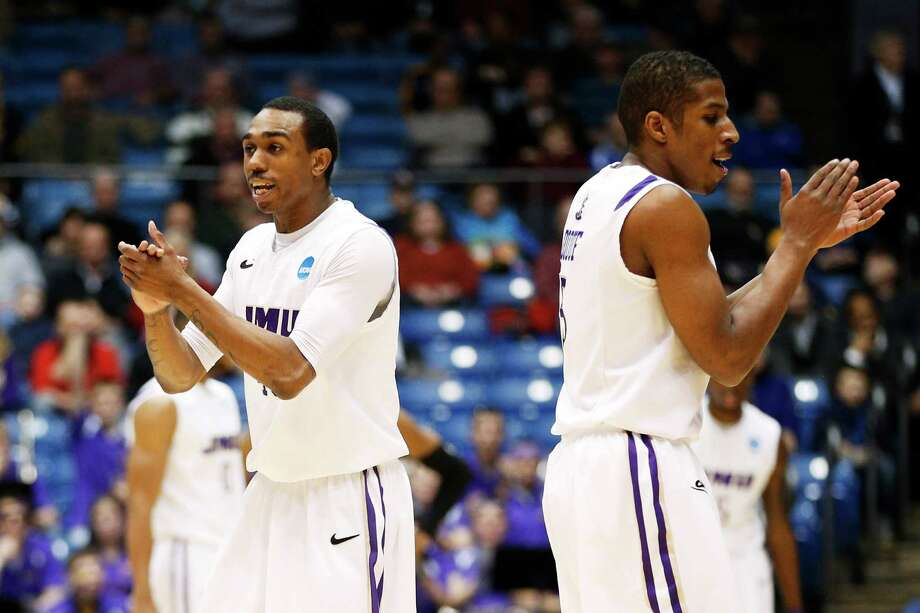 Devon Moore #40 and Alioune Diouf #5 of the James Madison Dukes react in the first half against the LIU Brooklyn Blackbirds. Photo: Gregory Shamus, Getty Images / 2013 Getty Images