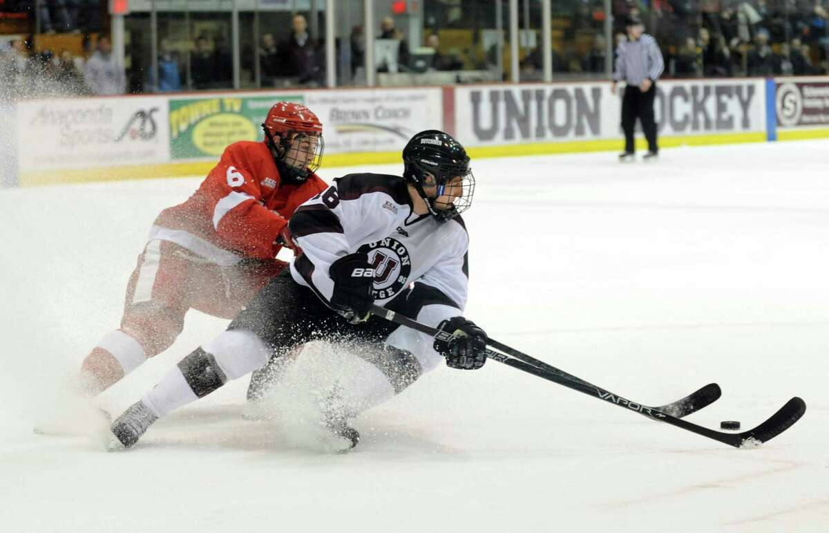 Union's Kevin Sullivan (16), right, applies the brakes to pass behind him as Cornell's Nick D'Agostino (6) defends during their hockey game on Friday, Jan. 18, 2013, at Union College in Schenectady, N.Y. (Cindy Schultz / Times Union)