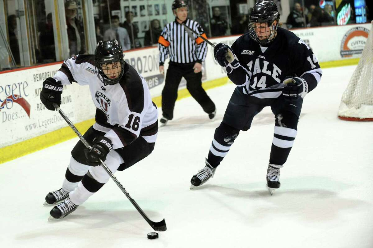 Union's Kevin Sullivan(16), left, guides the puck behind the net as Yale's Ryan Obuchowski defends during their hockey game on Friday, Feb. 15, 2013, at Union College in Schenectady, N.Y. (Cindy Schultz / Times Union)