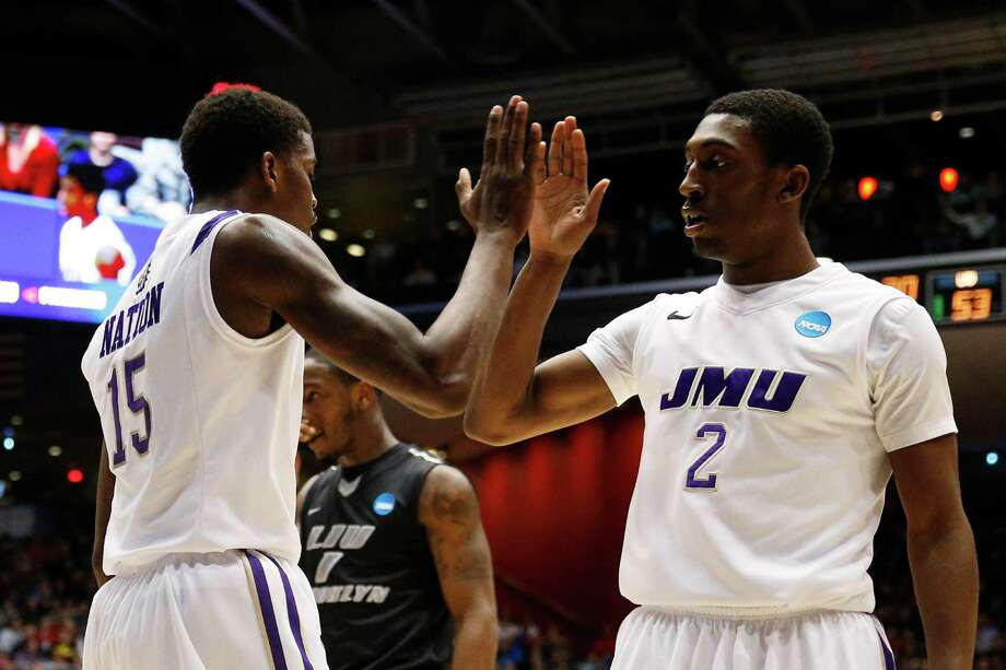 Ron Curry #2 and Andre Nation #15 of the James Madison Dukes celebrate in the second half. Photo: Gregory Shamus, Getty Images / 2013 Getty Images