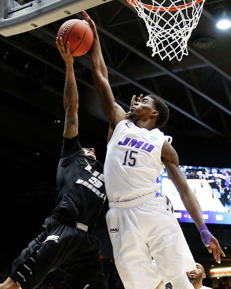 Andre Nation #15 of the James Madison Dukes blocks a second half shot by C.J. Garner #3 of the LIU Brooklyn Blackbirds. Photo: Gregory Shamus, Getty Images / 2013 Getty Images