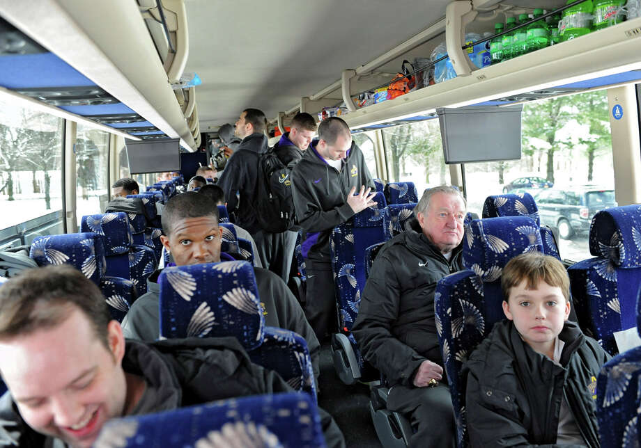 UAlbany men's basketball team boards a tour bus as they leave for the NCAA Tournament on Wednesday, March 20, 2013 in Albany, N.Y. (Lori Van Buren / Times Union) Photo: Lori Van Buren