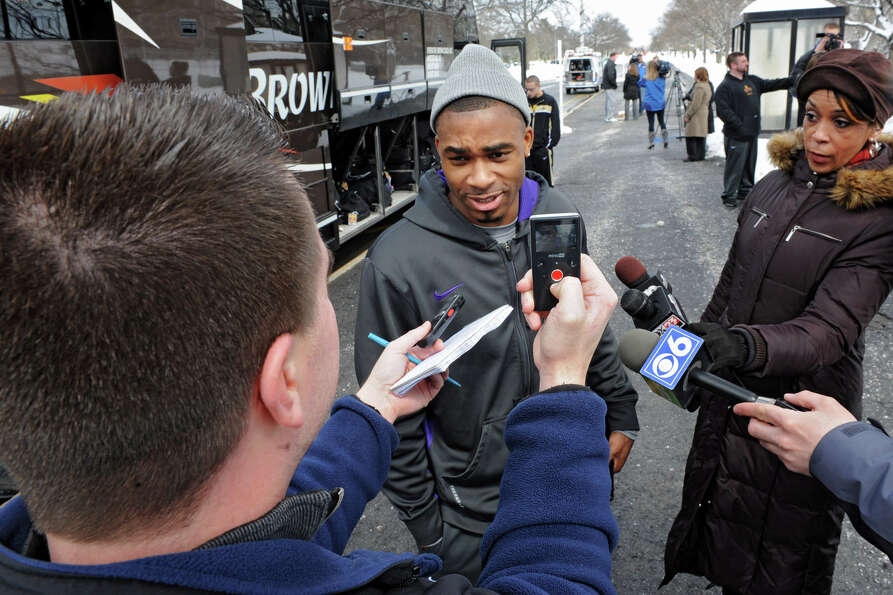 UAlbany basketball player Mike Black talks to the media boarding the tour bus as the team leaves for