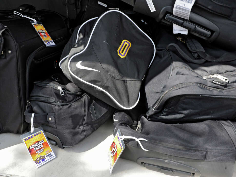 The UAlbany men's basketball team's luggage is stored in a lower compartment of the tour bus as the team leaves for the NCAA Tournament on Wednesday, March 20, 2013 in Albany, N.Y. (Lori Van Buren / Times Union) Photo: Lori Van Buren