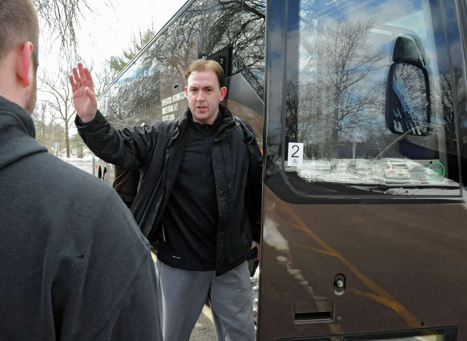 UAlbany men's basketball head coach Will Brown waves to the media before boarding the tour bus as the team leaves for the NCAA Tournament on Wednesday, March 20, 2013 in Albany, N.Y. (Lori Van Buren / Times Union) Photo: Lori Van Buren