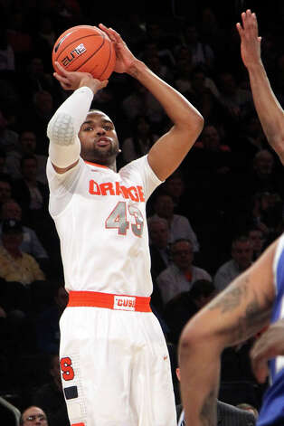 Syracuse's James Southerland shoots a 3-point shot during the first half of an NCAA college basketball game against Seton Hall at the Big East Conference tournament, Wednesday, March 13, 2013 in New York. (AP Photo/Mary Altaffer) Photo: Mary Altaffer