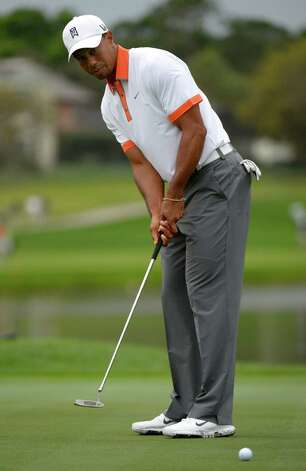 Tiger Woods watches his putt on the third green during the pro-am of the Arnold Palmer Invitational golf tournament in Orlando, Fla., Wednesday, March 20, 2013.(AP Photo/Phelan M. Ebenhack) Photo: Phelan M. Ebenhack