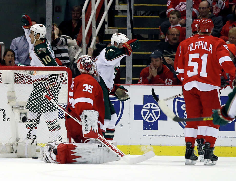 Minnesota Wild right wing Devin Setoguchi (10) celebrates his goal against Detroit Red Wings goalie Jimmy Howard (35) during the second period of an NHL hockey game Wednesday, March 20, 2013, in Detroit. (AP Photo/Duane Burleson) Photo: Duane Burleson