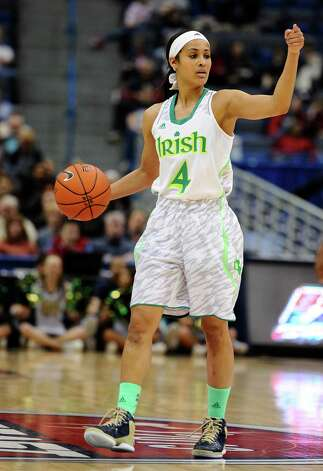FILE - This March 10, 2013 file photo shows Notre Dame's Skylar Diggins during in the first half of an NCAA college basketball game in the quarterfinals of the Big East Conference women's tournament against South Florida in Hartford, Conn. The neon-colored jerseys and camouflage-covered shorts debuted by six teams in their post-season conference championships ahead of the NCAA men's basketball tournament weren't well received in the press and social media. The changes happened to be in line with fashion runways and in recreational athleticwear, where highlighter brights and creative camo have been bona fide trends, and alternate uniforms have become part of the college football and basketball landscape, but on the court, these uniforms still made fans cringe. (AP Photo/Jessica Hill, file) Photo: Jessica Hill