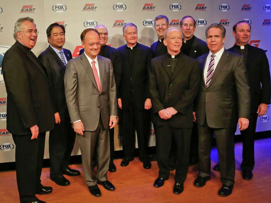 Villanova University President Rev. Peter Donohue, far left, Seton Hall University President A. Gabriel Esteban, second from left, Georgetown University President John DeGioia, third from left, St. Johns University President Donald Harrington, fourth from left, Creighton University President Rev. Timothy Lannon, fifth from left, Depaul University President Dennis Holtschneider, fifth from right, Providence University President Rev. Brian Shanley, fourth from right, Xavier University President Michael Graham, third from right, Butler University President Jim Danko, second from right, and Marquette University President Rev. Scott Pilarz, far right, assemble for a photo following a press conference on Wednesday, March 20, 2013 in New York.   Big East athletic conference member schools gathered in New York to announce developments helping to shape the new basketball-focused conference.  (AP Photo/Bebeto Matthews) Photo: Bebeto Matthews