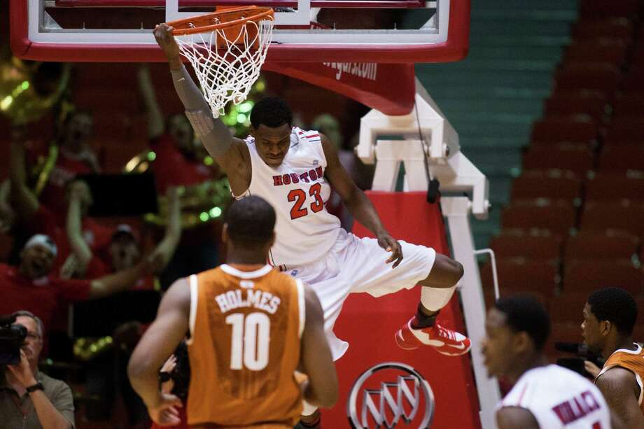 UH's Danuel House bends the rim in the first half before breaking UT's hearts in the second with his game-winning shot with 17 seconds to play. Photo: J. Patric Schneider, Freelance / © 2013 Houston Chronicle
