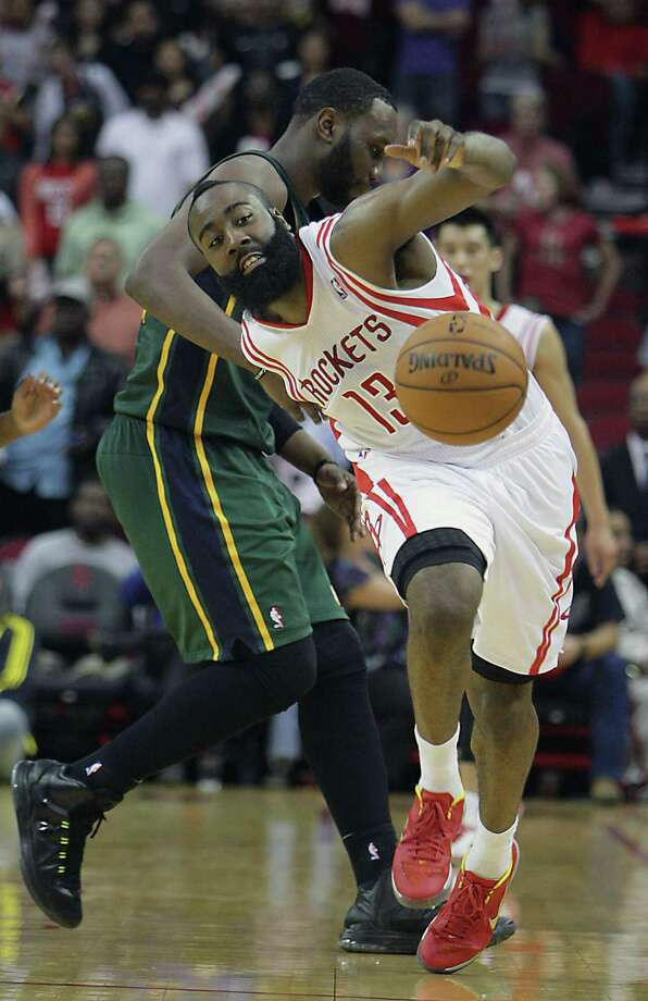Utah's Al Jefferson, left, fouls James Harden, who led the Rockets with 29 points Wednesday night. Photo: James Nielsen, Staff / © 2013 Houston Chronicle