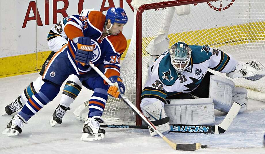 Antti Niemi makes a save on a shot by Edmonton's Ryan Smyth in the first period. Photo: Jason Franson, Associated Press