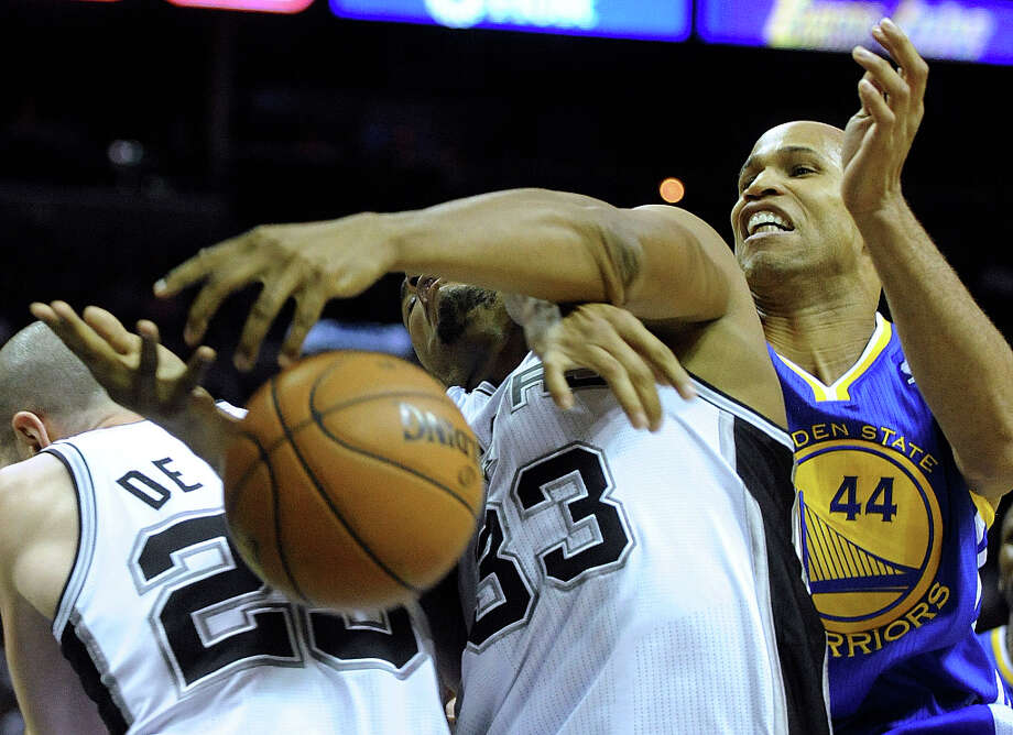 Boris Diaw of the San Antonio Spurs is tied up by Richard Jefferson (44) of the Golden State Warriors during NBA action at the AT&T Center on Wednesday, March 20, 2013. Photo: Billy Calzada, San Antonio Express-News / San Antonio Express-News