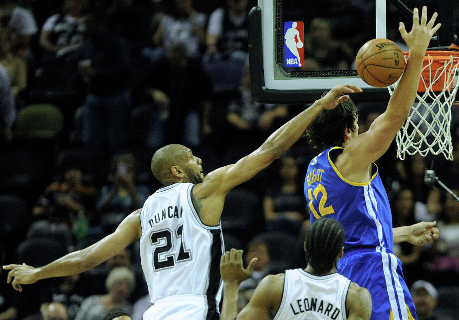 Tim Duncan of the San Antonio spurs blocks a shot by Andrew Bogut of the Golden State Warriors during NBA action at the AT&T Center on Wednesday, March 20, 2013. Photo: Billy Calzada, San Antonio Express-News / San Antonio Express-News