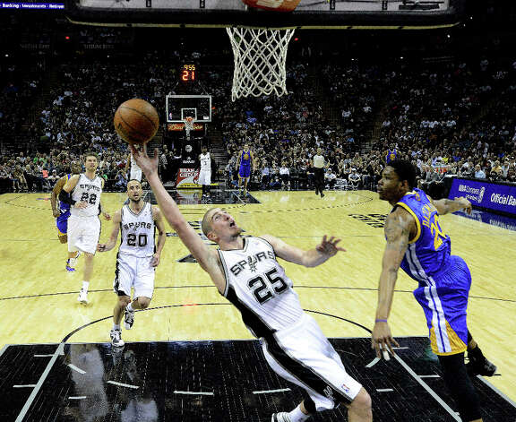 San Antonio Spurs guard Nando de Colo scores on a breakaway layup as Kent Bazemore of Golden State defends during second-half NBA action at the AT&T Center on Wednesday, March 20, 2013. The Spurs won, 104-93. Photo: Billy Calzada, San Antonio Express-News / San Antonio Express-News