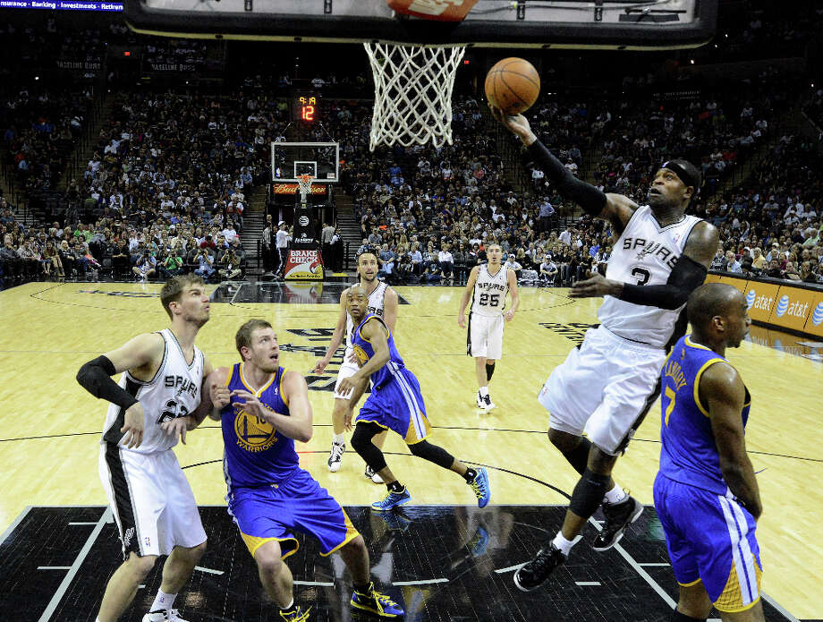 Stephen Jackson (3) of the San Antonio Spurs scores against Golden State during second-half NBA action at the AT&T Center on Wednesday, March 20, 2013. The Spurs won, 104-93. Photo: Billy Calzada, San Antonio Express-News / San Antonio Express-News