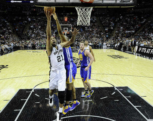 Tim Duncan of the San Antonio Spurs scores on a layup against Golden State during second-half NBA action at the AT&T Center on Wednesday, March 20, 2013. The Spurs won, 104-93. Photo: Billy Calzada, San Antonio Express-News / San Antonio Express-News