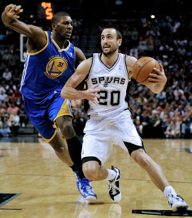 San Antonio Spurs' Manu Ginobili (20) of Argentina, drives around Golden State Warriors' Festus Ezeli during the first half of an NBA basketball game, Wednesday, March 20, 2013, in San Antonio. Photo: Darren Abate, Associated Press / FR115 AP